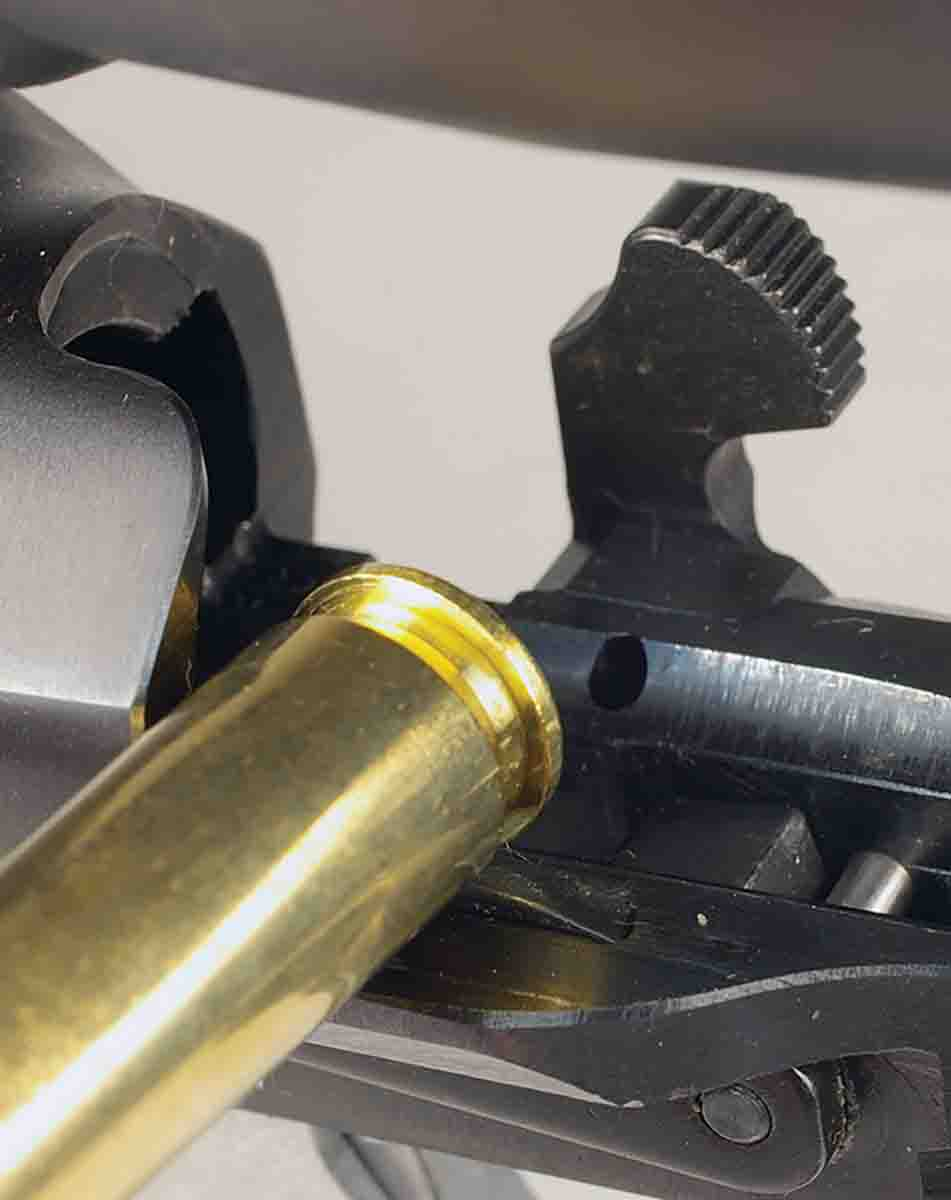 Pushing the CZ's bolt stop release requires using a fingernail or the rim of a cartridge case.