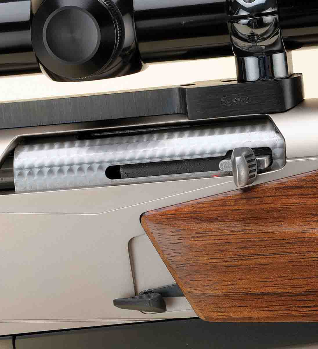 The release lever for the bolt is at the bottom center of the receiver. The bolt is jeweled for appearance and the forearm fits into a recess on the receiver.