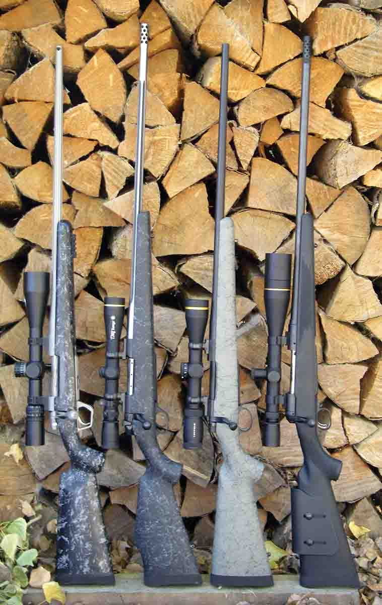 Popular long-range hunting rifles include (left to right): a Gunwerks LR-1000 .300 Winchester Magnum, Weatherby Mark V 6.5-300 Weatherby Magnum, Nosler Model 48 .28 Nosler and a Savage Model 111 Long Range Hunter 6.5-284 Norma.
