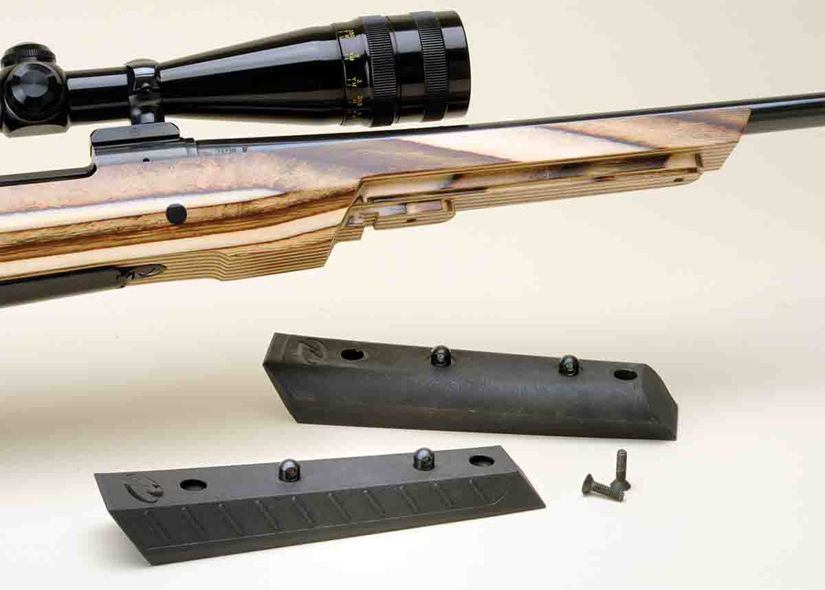 The forearm insert is interchangeable from sporter taper (bottom) to a wider version for varmint shooting.