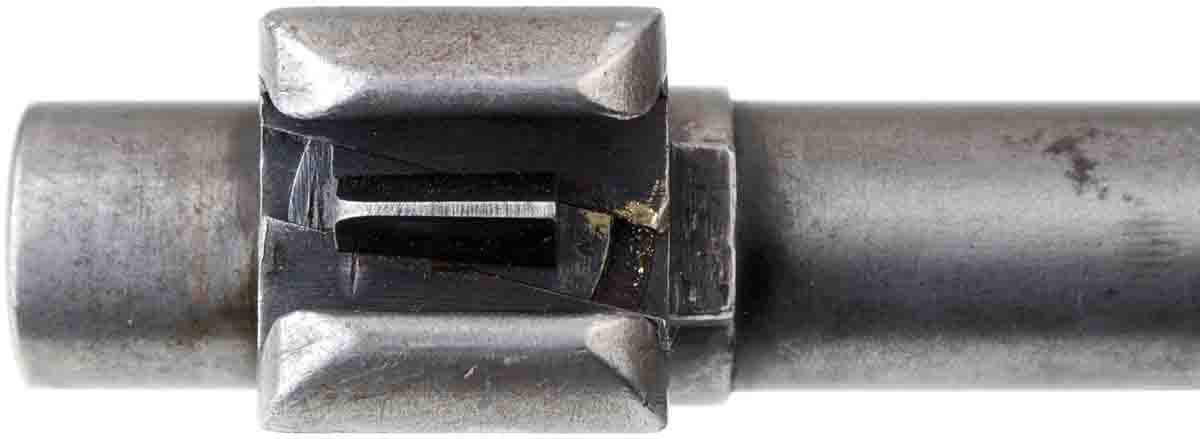 The Model 1935 front sight has a blade that runs in a slanted track. Note the brass smears from drifting it for zeroing.