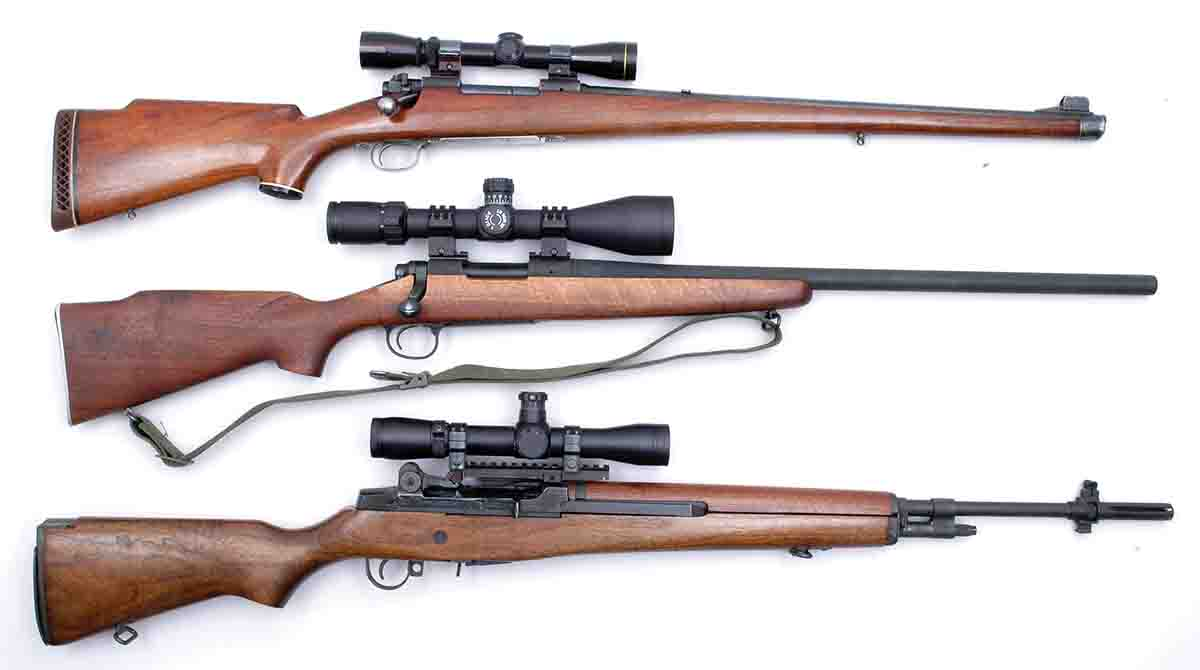 Mike's long-time favorite Model 70 Featherweight .308 Winchester (top) is shown with a couple of other previously owned .308s, including a Remington Model 700V and a Springfield Armory M1A.