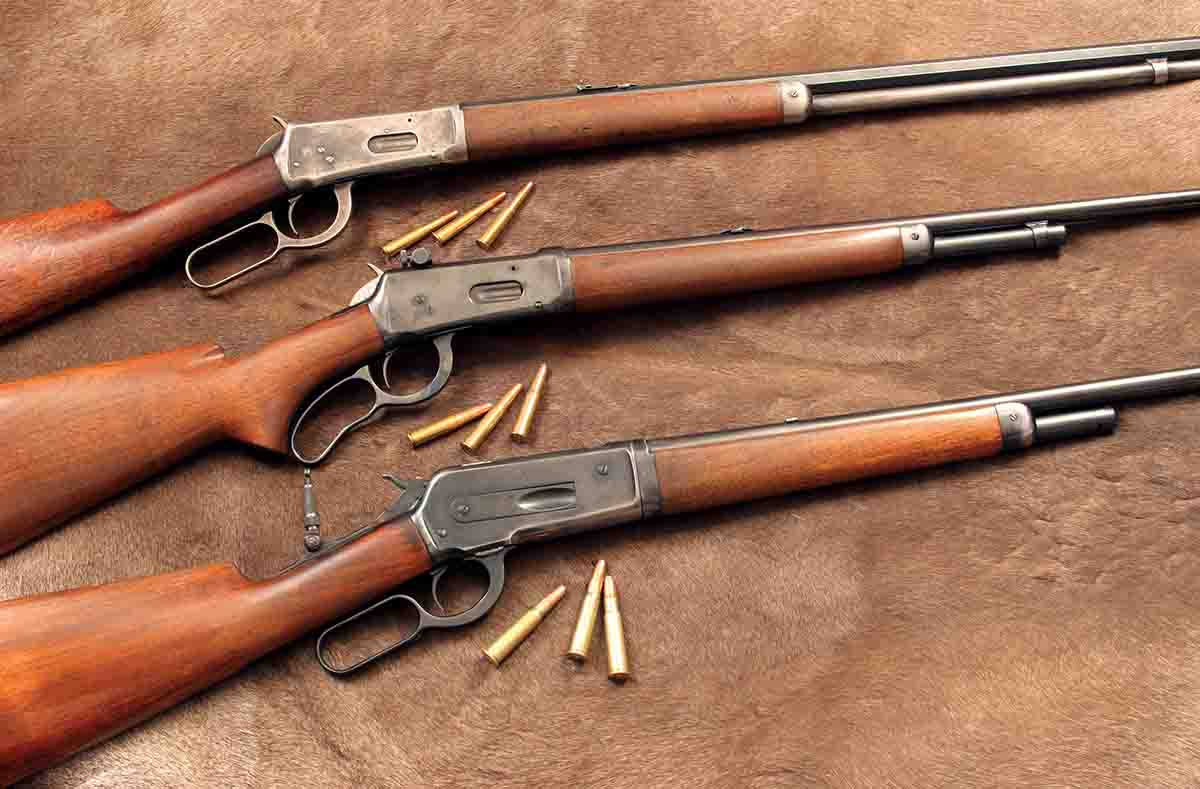 When smokeless lever-action cartridges started appearing in the 1890s, hunters immediately noticed how much flatter they shot than black-powder rounds. These rifles include (top to bottom): a Winchester 1894 .25-35 WCF, Winchester Model 64 .30 WCF and a Winchester 1886 .33 WCF.