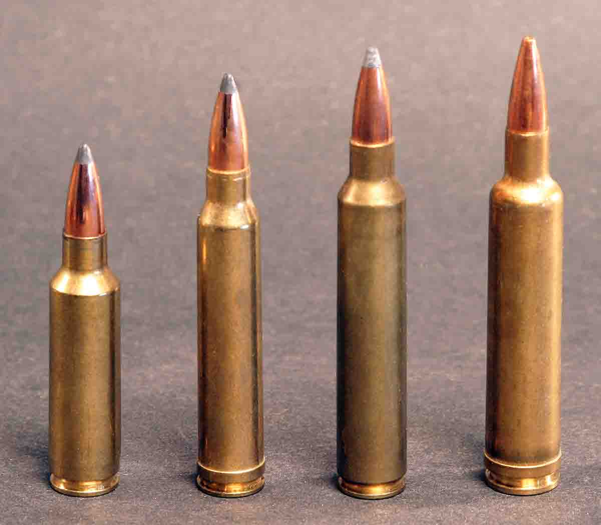 Thirty-caliber cartridges have often been crowded into bolt-action magazines, one reason some .30-caliber spitzers have relatively blunt ogives. They don't have to be seated as deeply, allowing more room for powder. This results in a little more muzzle velocity but reduces downrange velocity. Cartridges include (left to right): the .300 Winchester Short Magnum, .300 Winchester Magnum, .300 Remington Ultra Mag and the .30-378 Weatherby Magnum.