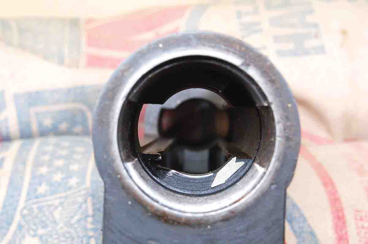 The arrow shows the right-hand bolt lug only contacts the receiver at the tiny bright area where blueing has been worn off.