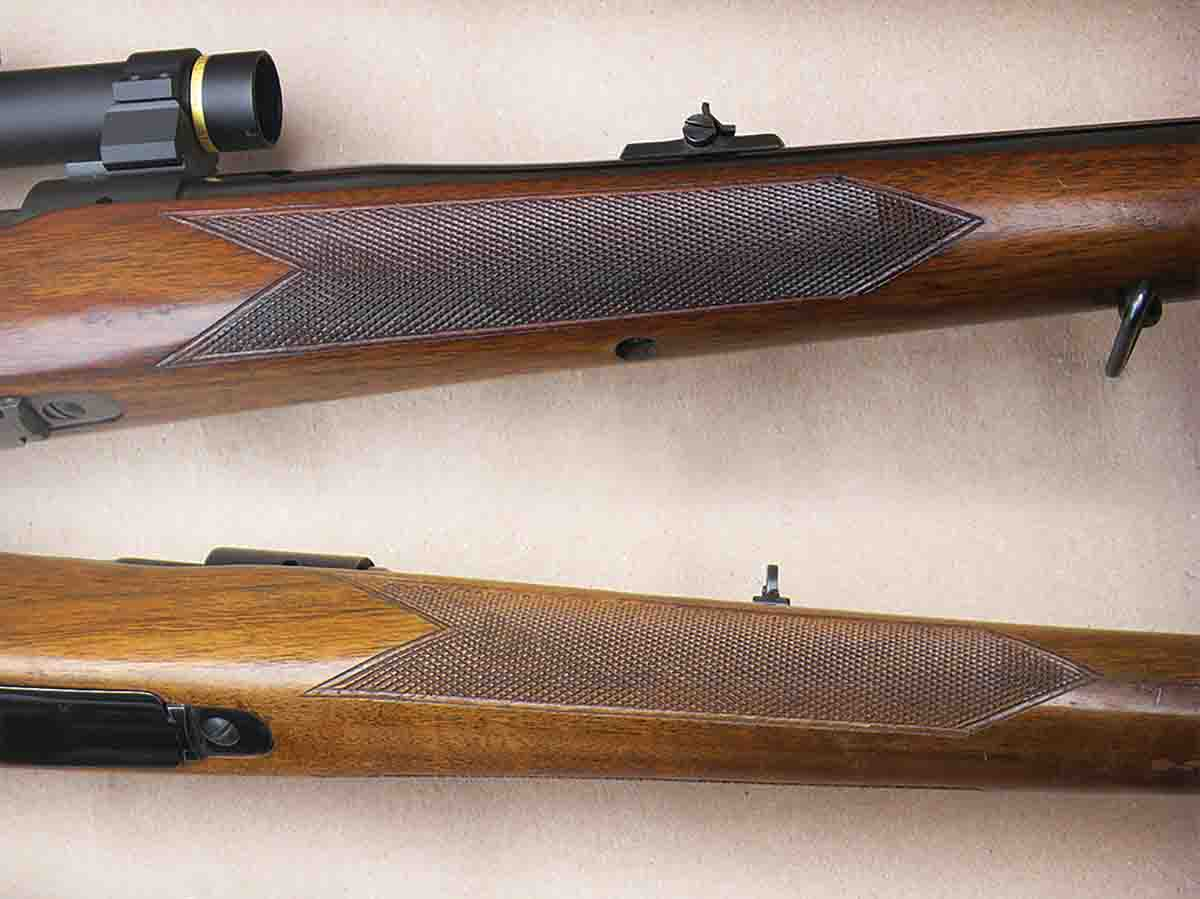 Standard weight Winchester pre-'64 Model 70 rifles (top) feature three guard screws. A fourth screw firmly secured the forearm to the barrel. Featherweight versions (bottom) were void of the barrel screw.