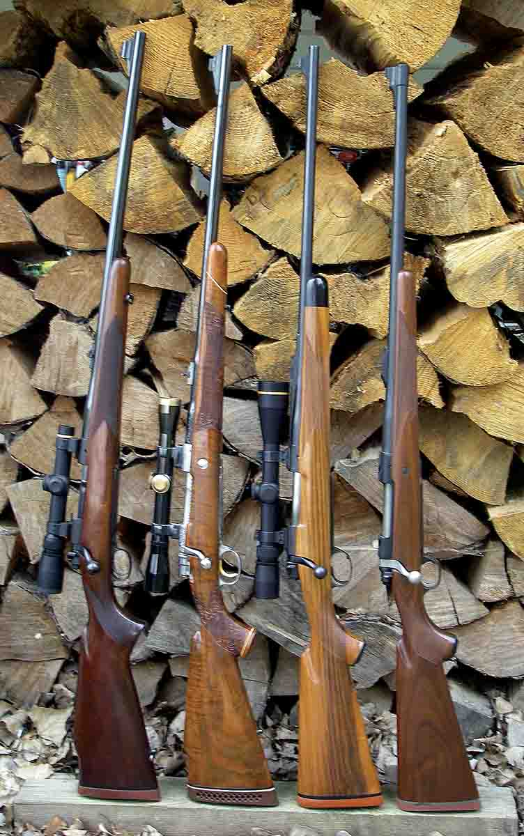 Many classic and modern wood stock rifles feature full-length barrel bedding. Examples include a (left to right): Winchester pre-'64 Model 70 .375 H&H Magnum, Browning FN High Power Olympian Grade .338 Winchester Magnum, Kimber of Oregon BGR 89 .300 Winchester Magnum and a Ruger M77 Hawkeye .375 Ruger.