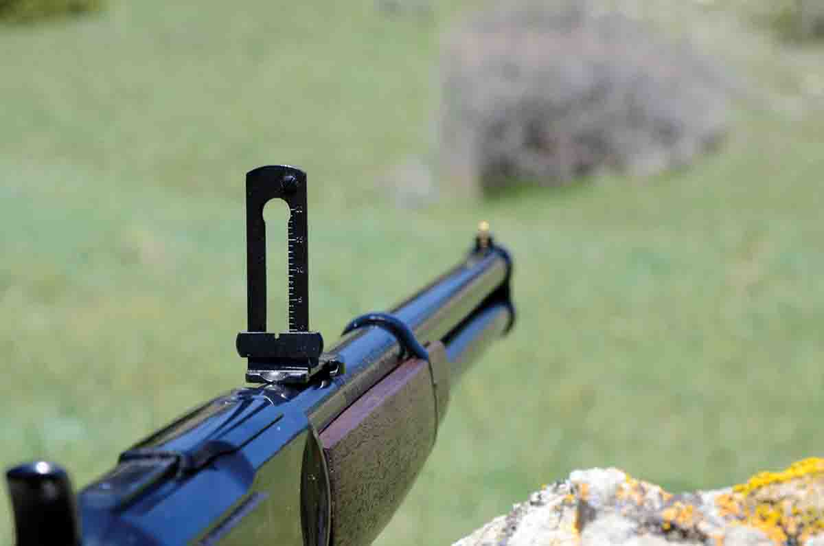 The rear sight on the Winchester SRC is a flip-up type with a notched slider for elevation.