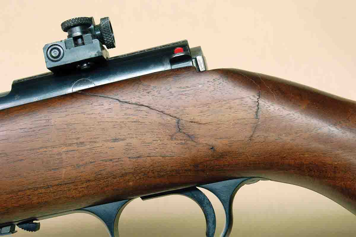 "A break at the wrist of this Browning .22 was drilled and a steel rod was inserted a few years ago. It is a Browning ""salt wood"" stock and will be replaced some day."