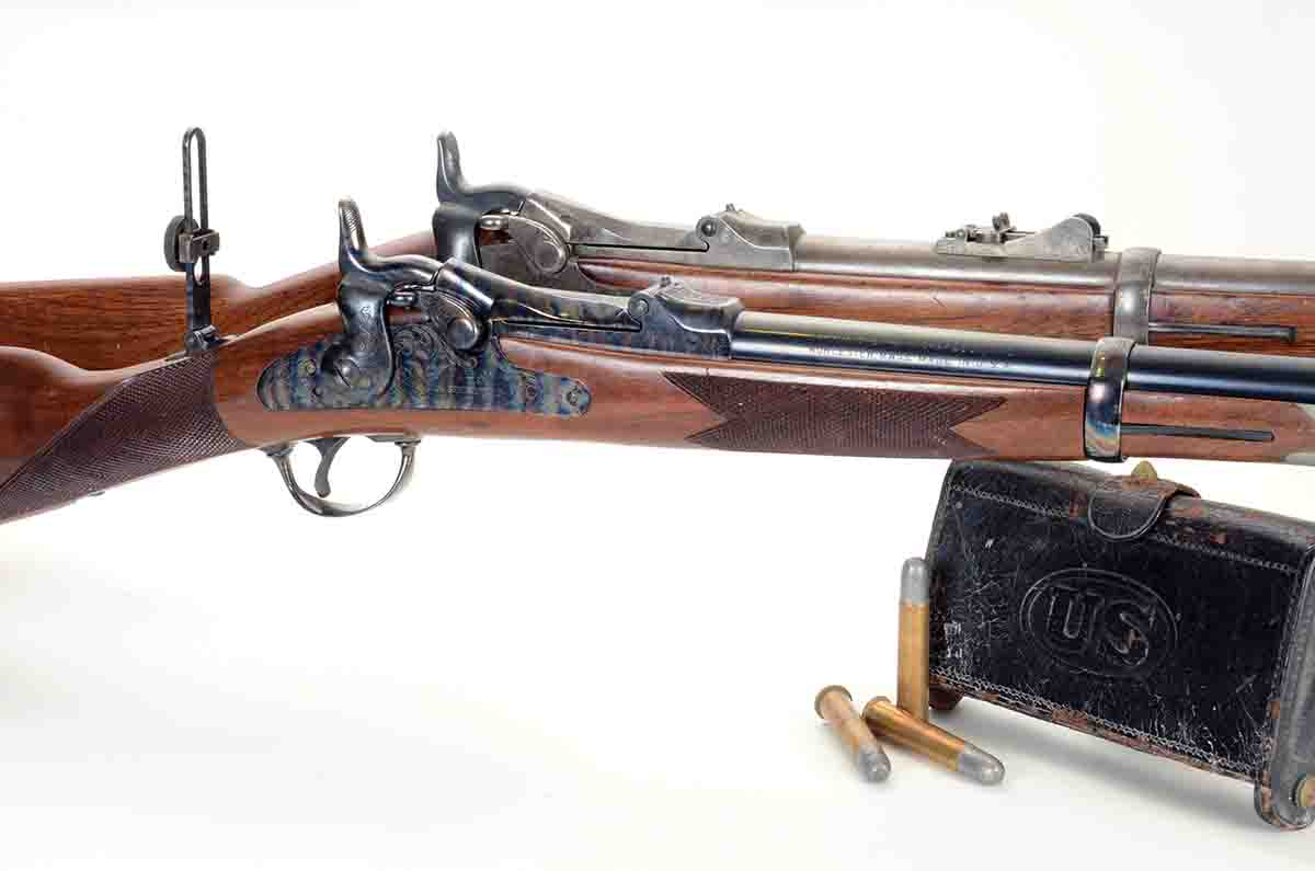 "One of the front runners of the single-shot renaissance was the (front) Harrington & Richardson Model 1873 ""Officer's Model trapdoor"" Springfield .45-70 shown here with an original Model 1873 carbine."