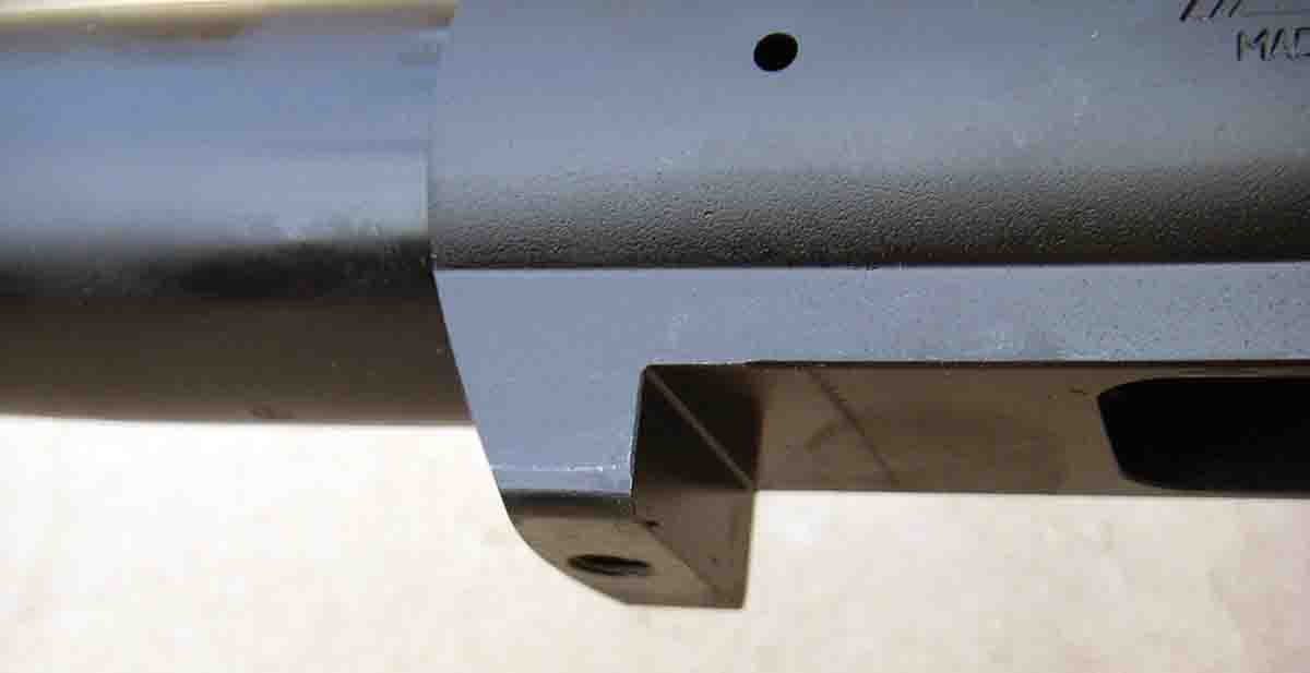 The recoil lug is integral to the flat bottom receiver.