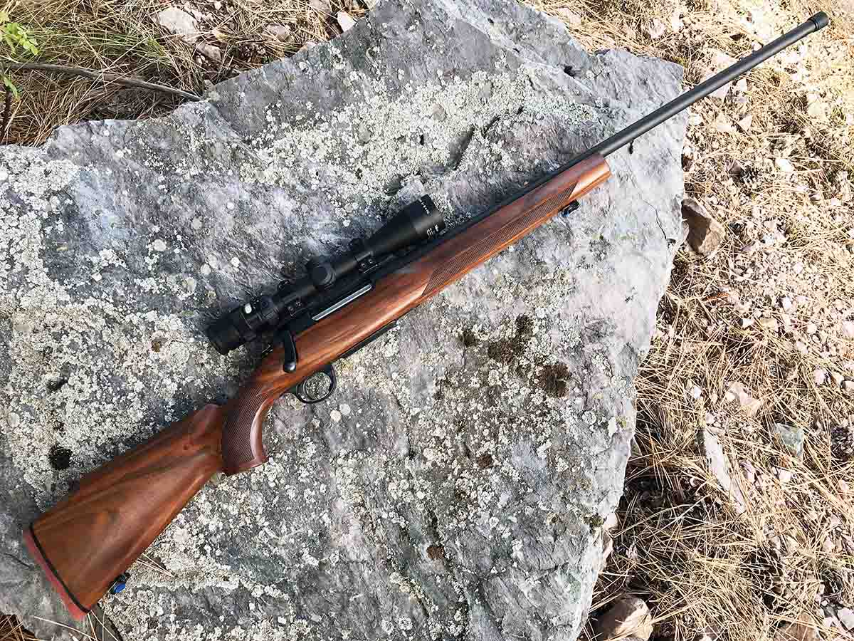 The Saphire's walnut stock features a high comb and full cheekpiece. A Trijicon 3-9x 40mm Accupoint scope was used to test accuracy.