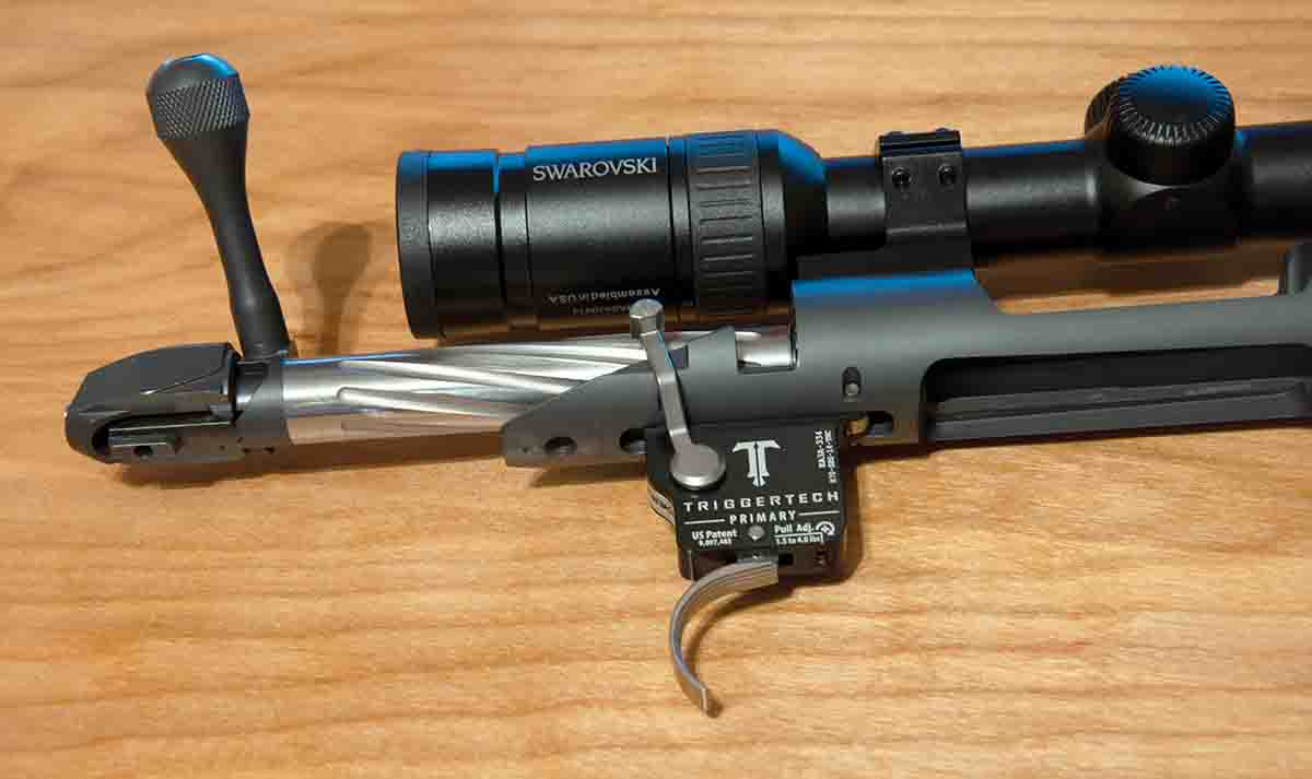 The rifle features a TriggerTech Primary trigger and a fluted bolt with a two-position safety.