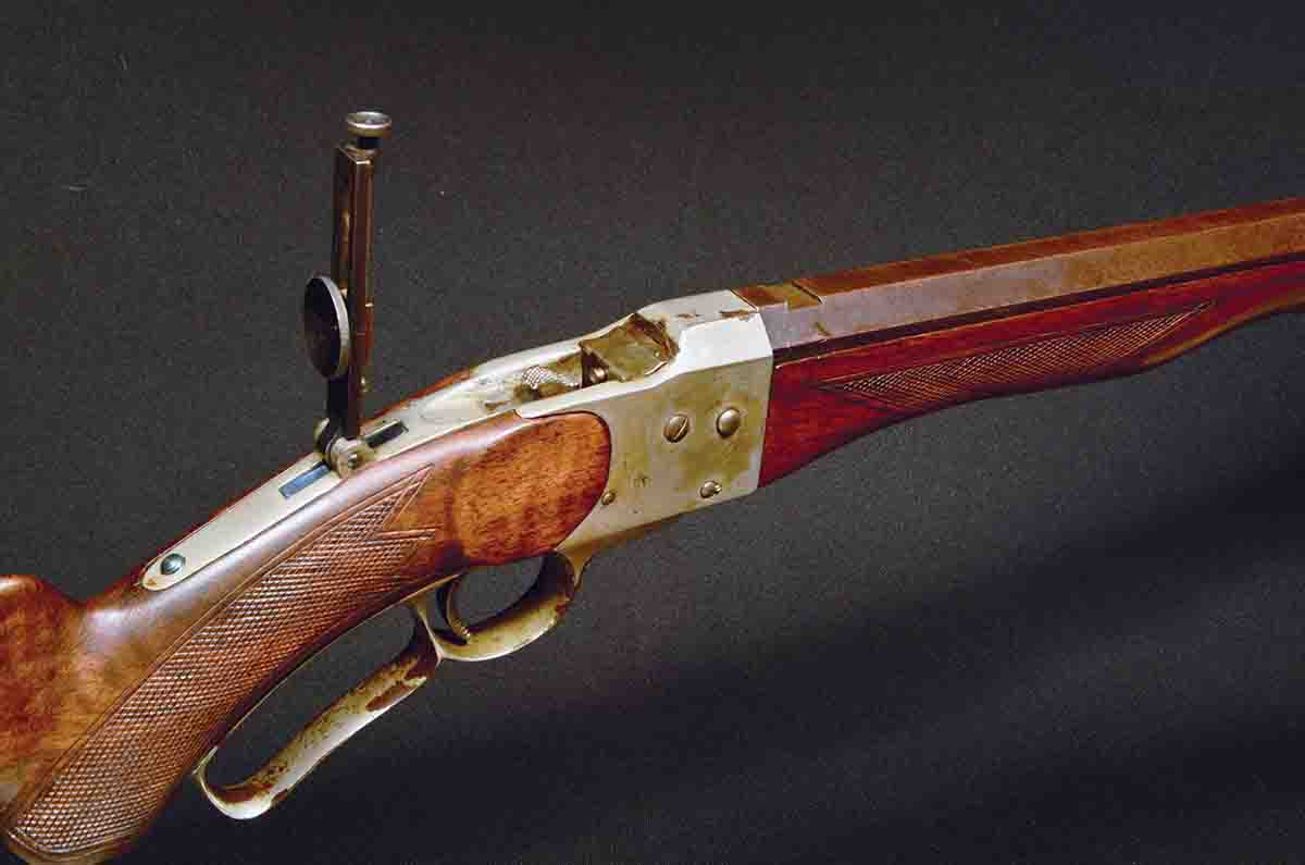 Early rifles featured standard mounted tang sights, but later production had the base machined integral with the tang.