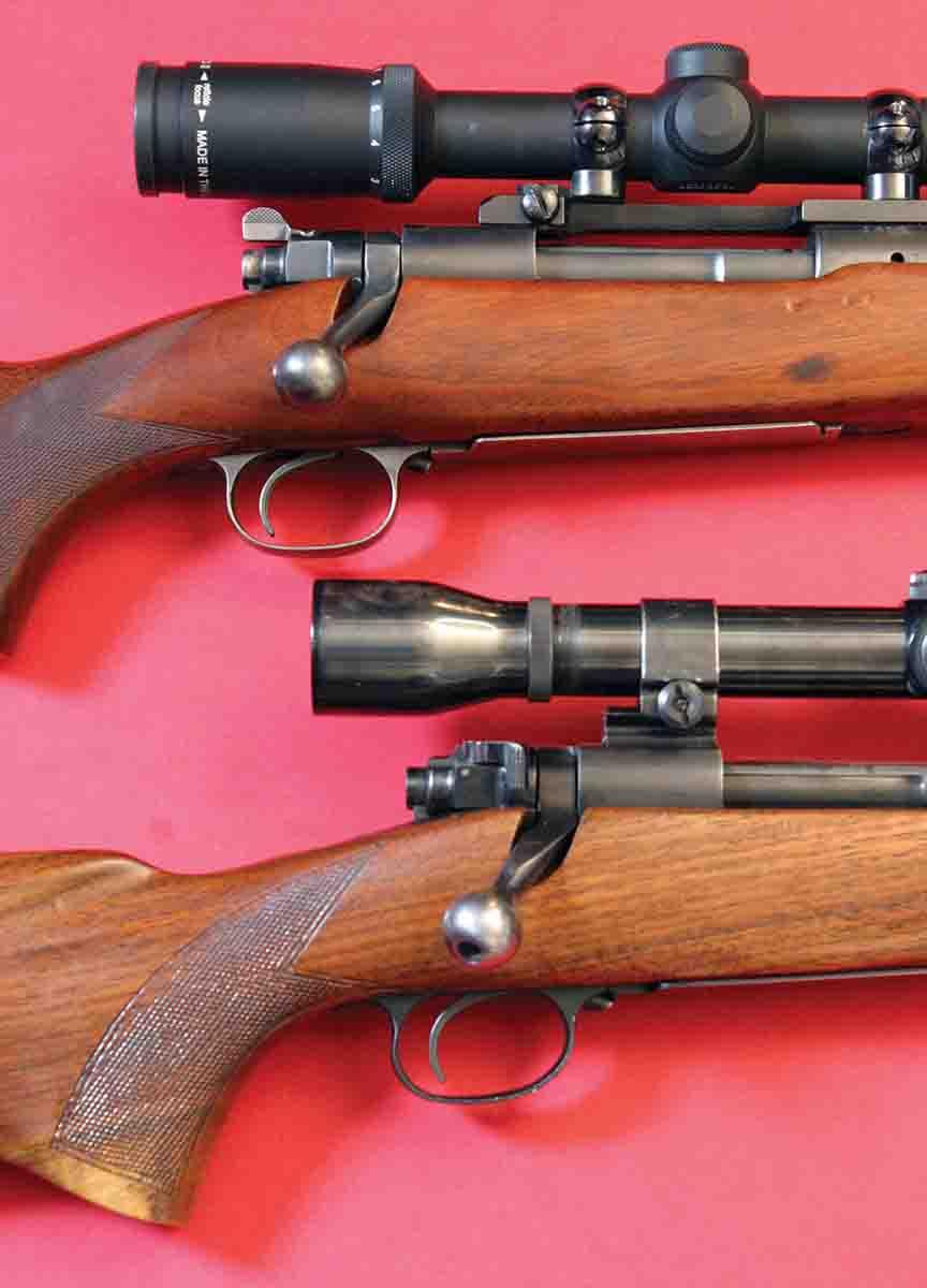 The difference in the prewar Model 70 safety (top, .257 Roberts) and the final, present design (bottom, Featherweight .308 made in 1953) plainly shows why the original did not work as well underneath low-mounted scopes.