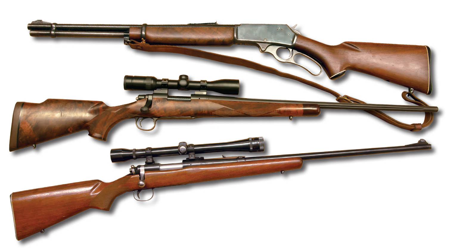 These rifles include (top to bottom) a cherished 1958 Marlin 336 .30-30, a Remington Custom Shop Model 700 6.5 Remington Magnum with a Swarovski Z3 3-9x 36mm scope and a Remington Model 722 .222 Remington with a Weaver K10 scope.