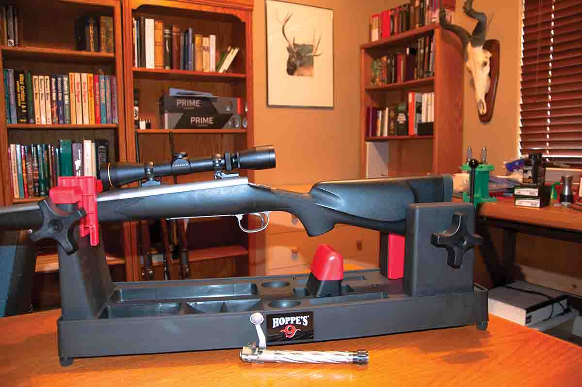 The plastic Hoppe's rifle vise is very sturdy and holds any bolt-action rifle securely. The rifle is a .270 Winchester made by High Tech Customs in Colorado Springs, Colorado.