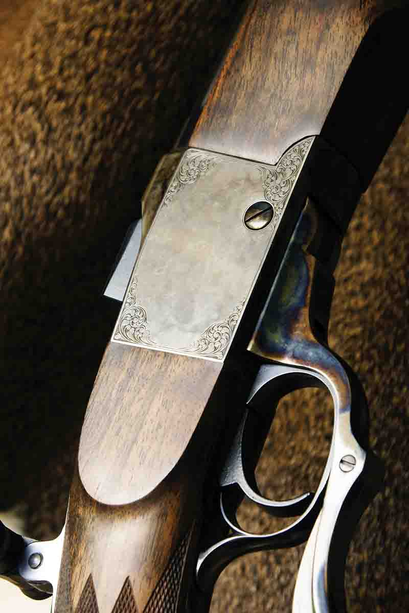 Minimalist engraving on a newly made single-shot, long-range rifle built on a modified Ruger No. 1 action. The engraving is 1890's-style American scroll by Sam Welch. Combined with subdued case-hardening, the effect is both restrained and  refined. The scroll breaks up the flat steel surface just enough.