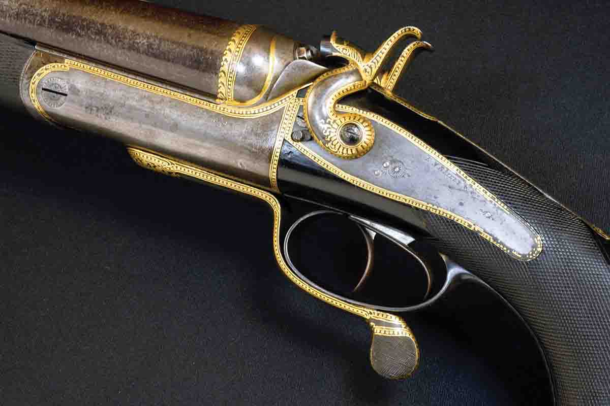 This E.M. Reilly 8-bore was made for an Indian Maharana, probably around 1900. For a maharaja rifle, this is almost  restrained. Oddly, there is little conventional engraving beyond the gold inlay, suggesting the work was carried out after the rifle was sent to India. It amounts to little more than a badge of office.