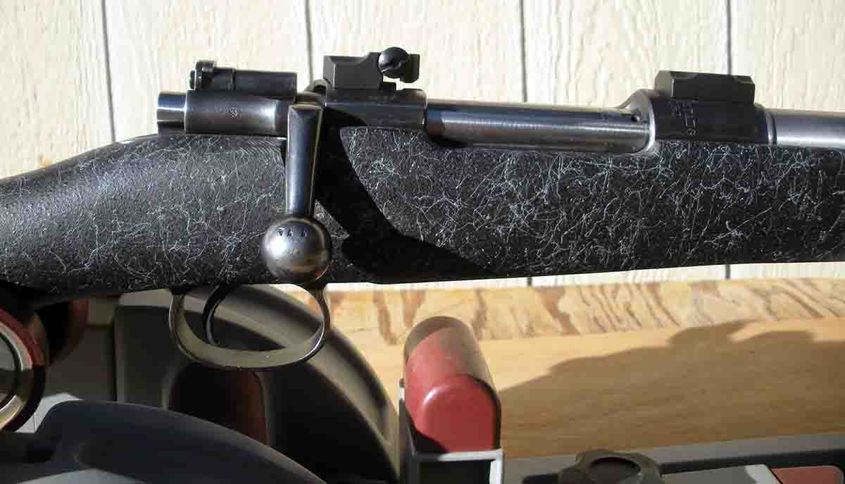 A view of the Model 96 Mauser action shows the striker for the cock-on-opening conversion with a Dayton Traister trigger, and contoured rear receiver ring to accommodate the Leupold-type rear scope base.