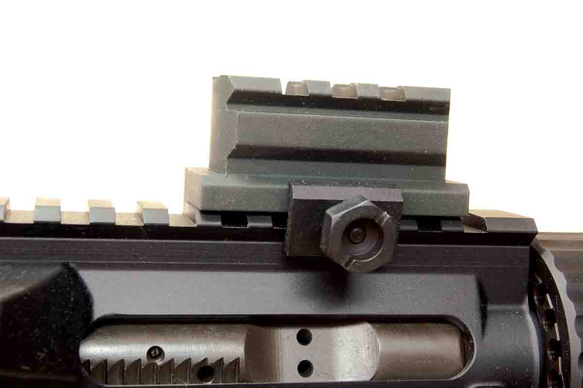 The riser block on an AR has a hex nut on a rail clamp, as do many such devices. The nut is half-inch or 13mm.