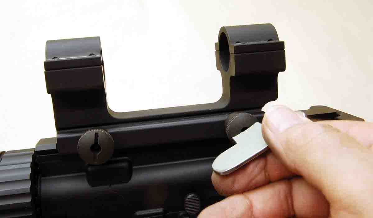 This scope mount for ARs uses a simple slotted clamp nut that fits a Weaver driver.