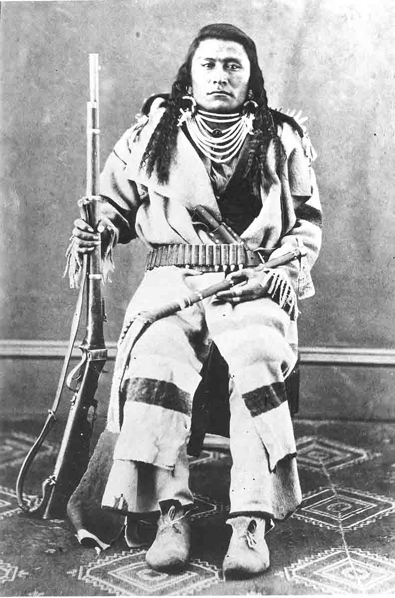 This Blackfoot warrior is shown with his Sharps military-style rifle with sling.