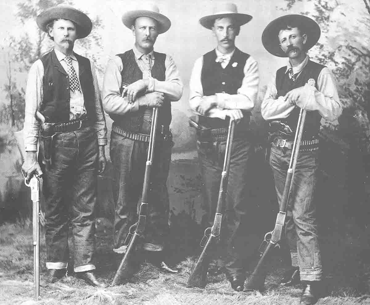 "The Diablo Canyon Posse included Carl Holton (1), Jim Black (2) and Ed St. Clair (4) with Model 76 Winchesters. Sheriff William ""Buckey"" O'Neill (3) holds a Model 86."