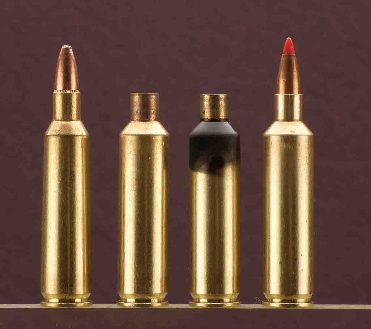 The first case is .22-250 Remington ammunition followed by the Improved case, a blackened case for die adjust­ment and the loaded  Improved cartridge.