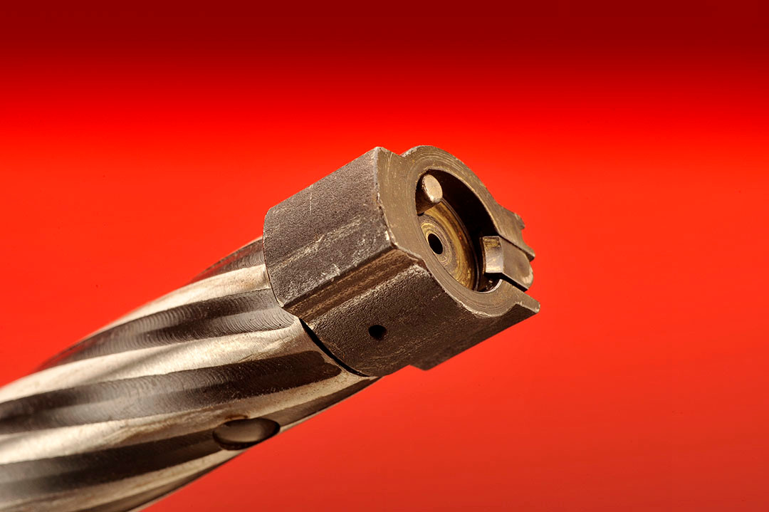 The bolt has twin locking lugs with the typical extractor and plunger ejector within the bolt face. The bolt body has spiral fluting.