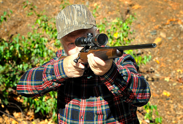 Photo of Stan firing the Mossberg Revere rifle.