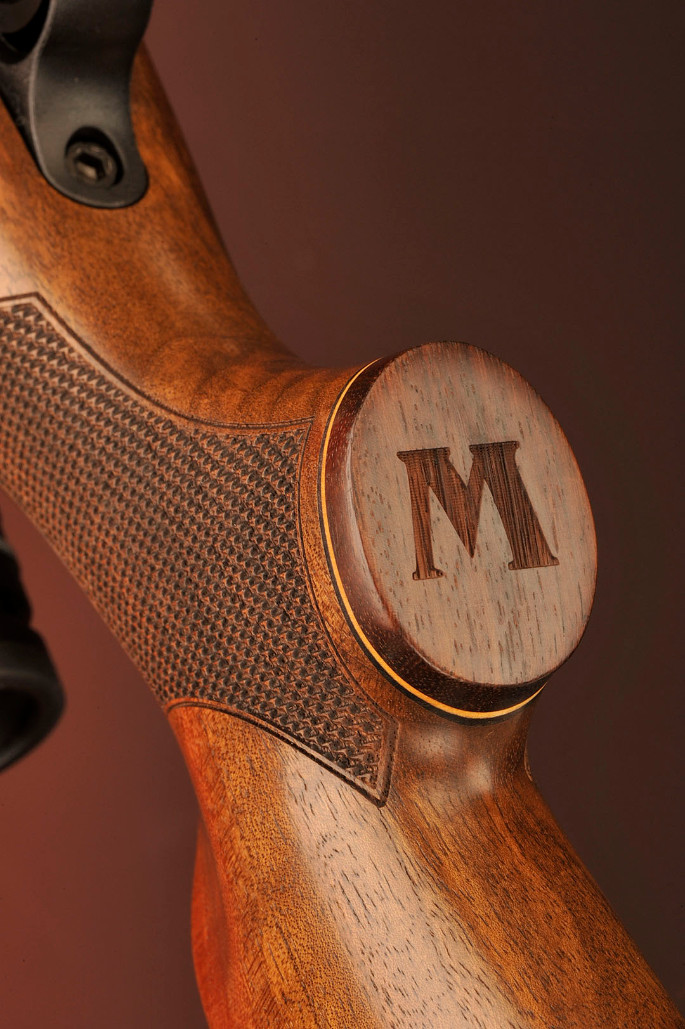 "On the pistol grip cap, the ""M"" for Mossberg has been tastefully laser cut adding some class to this rifle."