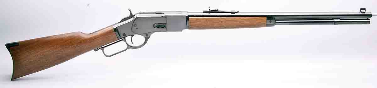 This M73 short rifle (circa 2015) with a 20-inch barrel is a reproduction manufactured in Miroku, Japan.  This M73 carbine features early model sights and raised ridges on either side of the receiver to accommodate  the dust cover. The flat – front to back – receiver ring indicates it is chambered for .44 WCF.