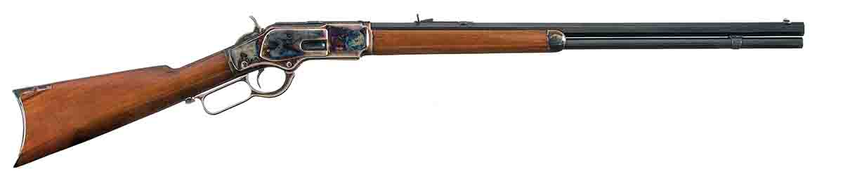 This early M73 rifle features a color case receiver, hammer, grip cap and crescent steel buttplate. Note the stepped receiver ring for smaller calibers and integral dust cover guide.  This M73 musket shows standard features, including barrel bands, 30-inch barrel, leaf-type rear sight and integral dust cover guide.