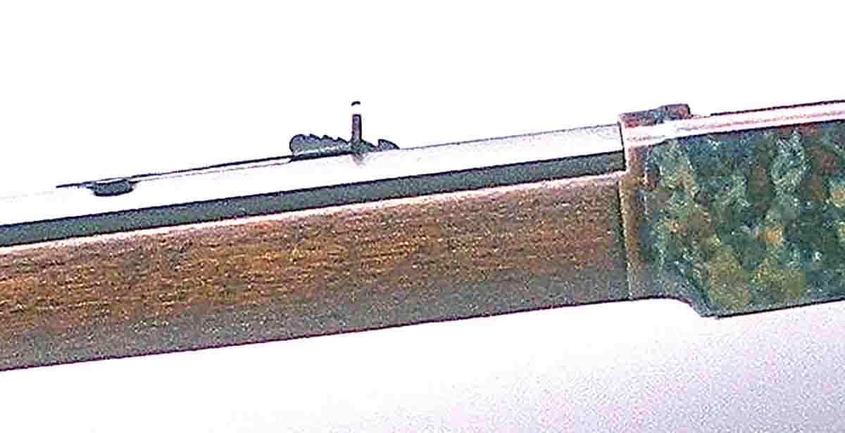 The steep elevator under the rear sight denotes black-powder era. Rifle sights are calibrated for standard .38 WCF black-powder loads in 50-yard increments to 300 yards.