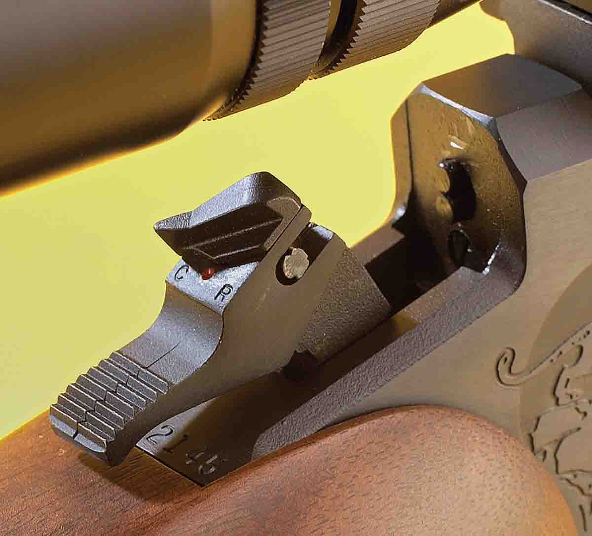 The hammer on the Contender is made to fire both rimfire and centerfire barrels. Note the dual firing pins just forward of the hammer.