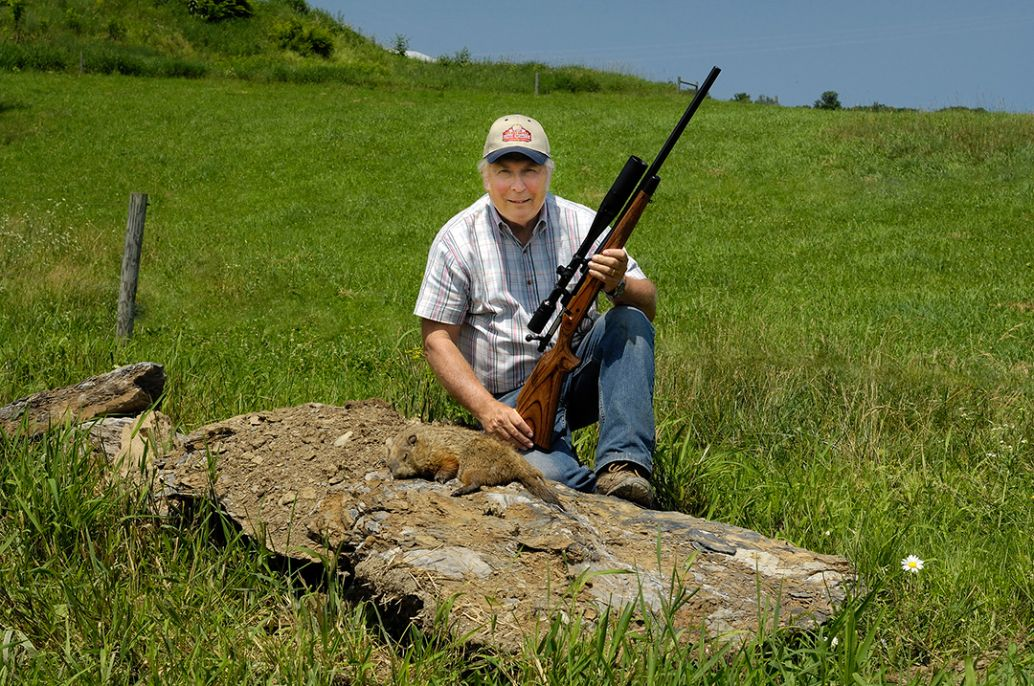 It was a long walk from the crest of the hill in the background, but this chuck was easy prey for the 6mm Remington. Stan took the shot from resting the gun on the boulder he is sitting on.