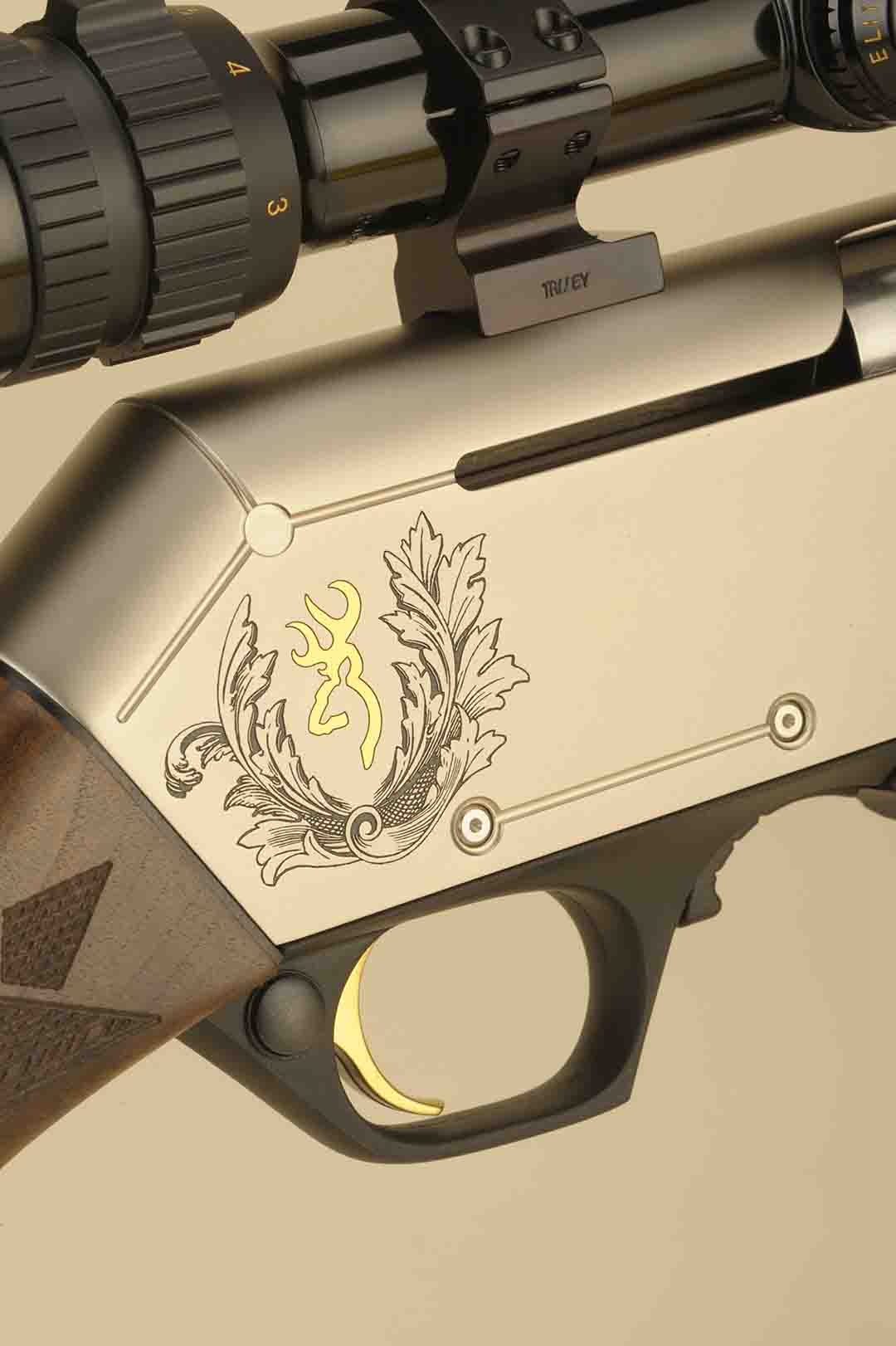 This photo shows the detailing with the MK 3 model with the high relief engraving. The cross bolt safety is standard as well as the gold-plated trigger.