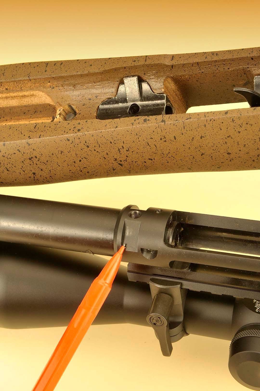 Here, you can see how Ruger's Power Bedding integral bedding block is set up within the rifle. On top is the block with light-colored notches, while the bottom shows how they fit within the confines of like notches on the receiver. Everything fits without any fuss when taking the rifle apart for maintenance and placing it back again.
