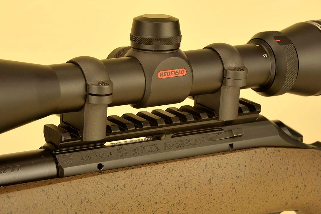 "Ruger has always been known for the ""added-value"" details and on this long-range rifle, an aluminum scope rail is included for mounting. To this, a full-sized one-inch Redfield scope was attached in Leupold rings. Bolt release is just below the rear scope ring and base."